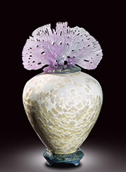 It was Tiffany who trademarked the word 'Favrile,' an old French term for 'handmade' in 1894, an ethos at the forefront of Debra Steidel's artwork. As the conviction of Debra Steidel's sculptures speak through the harmonious bond between the form of each vessel and intricacy of each sculptural lid, the vitality of the lidded sculpture has never been so alluringly present. The defining influence of Art Nouveau undoubtedly lingers in the expression of each Steidel masterpiece, yet perhaps the most fascinating parallel between Debra's mixed media sculpture and the brilliance of the Nouveau legendaries is the uncanny resemblance to René Lalique's (1860 -1945) sinuous creativity and artistic genius